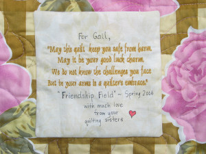 label on a cancer comfort quilt made by quilters who had each signed
