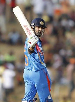 gautam gambhir india s gautam gambhir raises his bat after scoring a ...