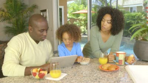 Superstock African American Brother And Sister Talking Kitchen