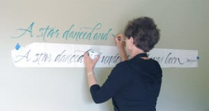 Writing a Shakespeare quote with acrylic paint for a client. The paper ...