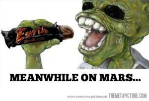 funny alien Mars eating candy bar