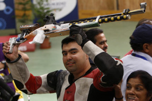 Shooter Gagan Narang hoists his rifle after winning the gold medal in ...