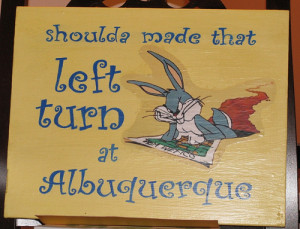 sign featuring phrase 'Shoulda made that left turn at Albuquerque ...