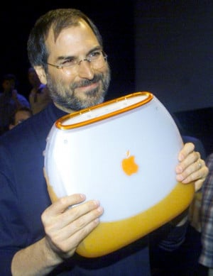 Apple Computer Chief Executive Steve Jobs poses with the company's new ...