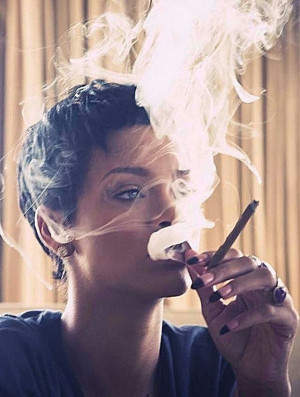 Rihanna smoking a blunt.