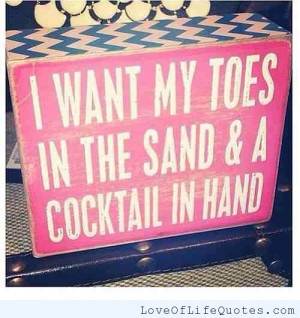 Toes in the sand, cocktail in hand