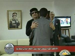 Libyan leader Muammar Gaddafi greets Kirsan Ilyumzhinov, the president ...