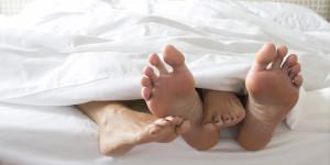 COUPLE-CUDDLING-BED-facebook.jpg