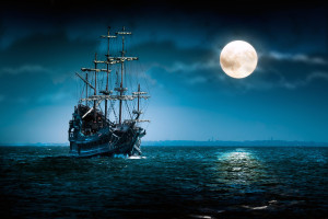 One beautiful pirate ship sailing in blue ocean by the bright full ...