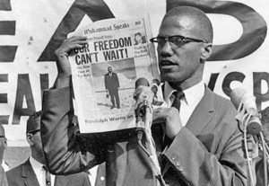 MALCOLM X HERE AT A BLACK MUSLIM RALLY ON AUGUST 6, 1963