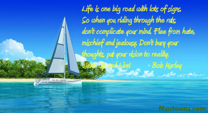 Yacht-near-the-tropic-island-with-bob-marley-quote