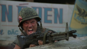 Animal Mother ( Adam Baldwin ) shoulders his M60 while looking over ...
