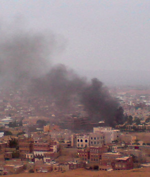 Smoke rises from the area around the U.S. embassy in Sanaa September ...