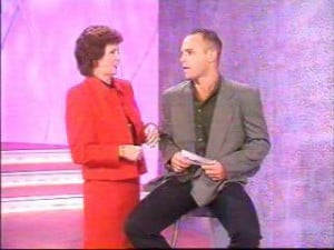 Host, Cilla Black , with the question-asking contestant