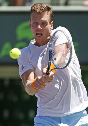 Tomas Berdych returns a shot to Andy Murray during the men s