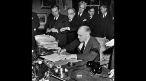 President Franklin D. Roosevelt (wearing black armband) signing ...