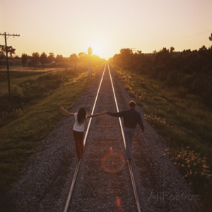 Couple Walking on Railroad Tracks Holding Hands Photographic Print