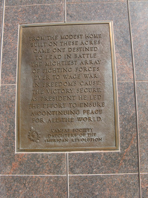 Quote on one of the plaques behind the statue.