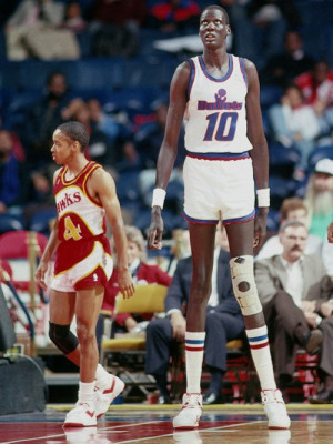 old school nba…. Manute Bol and Spud Webb