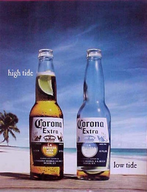 ... on a sunny beach: One full Corona bottle and one bottle almost empty