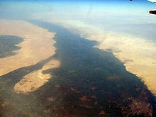 It flows through old hushed Egypt and its sands,