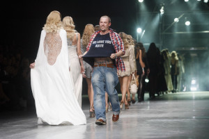 2005 Showing his support for friend Kate Moss at Paris Fashion Week.