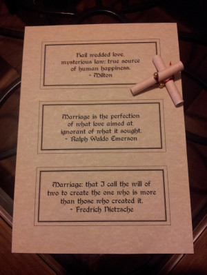 Scrolls with love and marriage quotes as wedding favours.