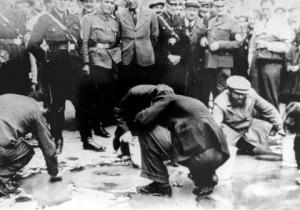 Jews in Vienna forced to scrub Schuschnigg's slogans off the sidewalk