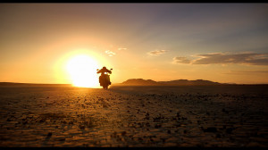Motorcycle Riding Off Into Sunset