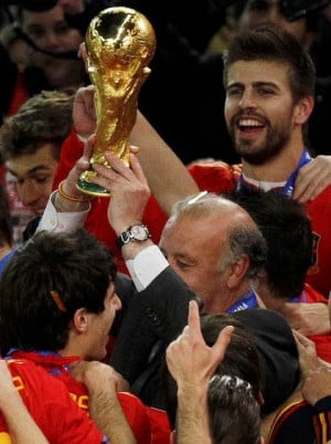 Vicente Del Bosque, centre, holds up the World Cup. Photo: AP