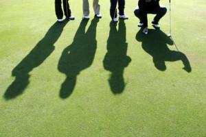 Golfers on the golf pitch. - Jochen Tack/ arabianEye/ Getty Images