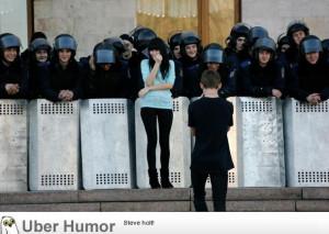 Guy taking photo of his girlfriend w/ Ukrainian riot police.