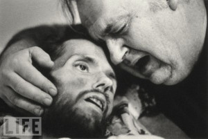 Bill Kirby tries to comfort his dying son, David, an AIDS patient ...
