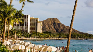 is an urban beach, flanked by iconic volcanic cone Diamond Head ...