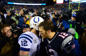 Patriots quarterback Tom Brady (12) shakes hands with Andrew Luck ...