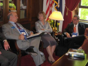 ... ® John Veneris (left) talks with U.S. Congresswoman Judy Biggert