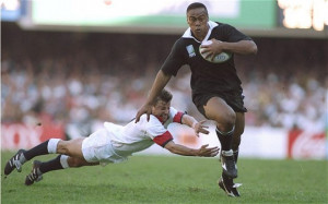 Catch me if you can: Jonah Lomu evades the diving tackle of Rob Andrew ...