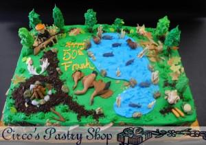 Hunting Birthday Cake with edible Fondant Animals, lake, and hunter