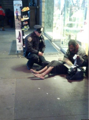 NYPD-COP-GIVES-HOMELESS-SHOES-facebook.jpg