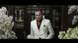 Gatsby, pale as death, with his hands plunged like weights in his coat ...