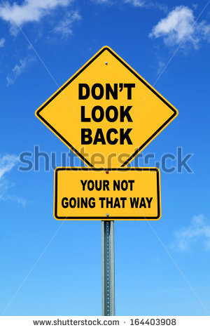 Yellow cautionary road sign don't look back - stock photo