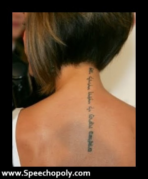 Wonderful Hebrew Tattoo On Girl Upperback