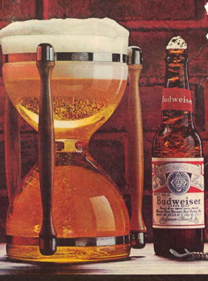 An old magazine Budweiser ad featuring an hourglass filled with beer ...