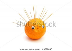 Funny Hedgehog Made Orange Fruit And Toothpicks White Background