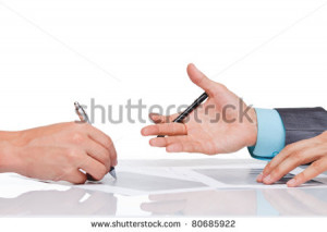 Hands of business people in elegant suits sitting at desk working in ...