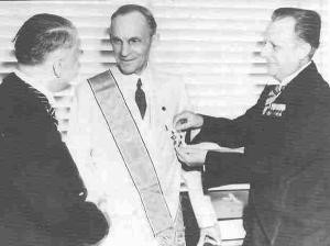 Henry Ford receives the Grand Cross of the German Eagle in 1938 from ...