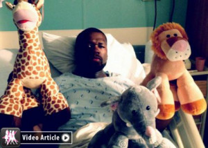 ... in a hospital bed before going under the knife on Wednesday (May 16