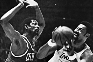 Wilt Chamberlain of the Los Angeles Lakers tries to shoot over Bill ...