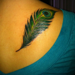 Tattoos with feathers and sayings