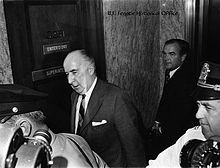 Former Attorney General Mitchell enters the Senate caucus room to ...